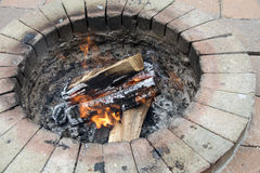 Fire pit with burning logs Stock Photography