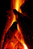 Fire Pit Closeup. A flickering fire pit at night while camping Stock Images