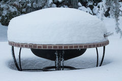 Fire Pit Covered in Deep Snow Stock Photo