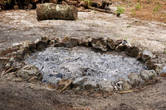 Fire pit filled with burnt ash Royalty Free Stock Photos