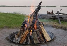 Fire pit at the lake. stock image