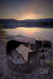 Fire Pit at Mountain Campsite. A firepit near a still mountain lake in the wilderness Royalty Free Stock Images