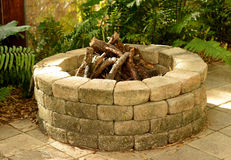 Fire pit. Stone fire pit with bricks in the backyard Royalty Free Stock Photography