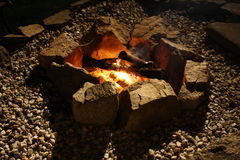 Fire pit. Stone Fire Pit night time glow Royalty Free Stock Images