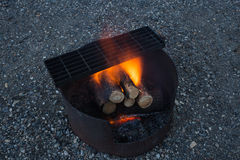 Fire Pit. A well lit campfire due to a fresh addition of dry lumber Stock Photography
