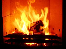 Fire place. Wood stove with burning orange flames Royalty Free Stock Photography