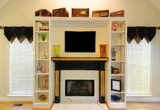 Fire Place. With shelving in a modern home Royalty Free Stock Photos