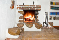 Fire place. In old cellar, chimney nippers, books royalty free stock photos