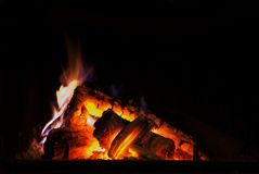 Fire place. Burning fire place on a Winter evening Royalty Free Stock Photo