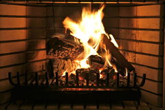 Fire place. Indoor fire place with logs on fire royalty free stock images