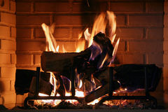 Fire place. With logs on fire royalty free stock photography