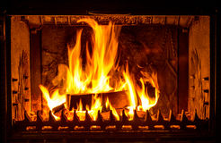 Fire place. Flames of fire burning in fire place royalty free stock photo