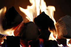 Fire place flames. Warm and soft focus image with flames from a fire place stock image