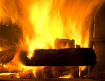 Fire place with wood and flames Royalty Free Stock Images