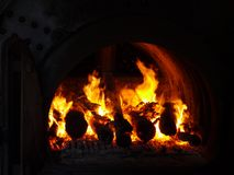 An open fire in a fire place Stock Photo