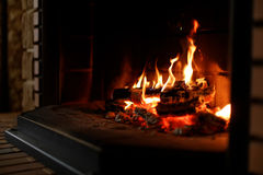 Fire place at home. At the fire place on wooden panel royalty free stock images