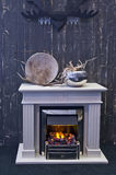 Fire place with horn. Detail of interior with fire place and horn royalty free stock photography