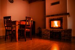 Fire place in a rustic decorated room. Fire place in rustic decorated room warm and rustic royalty free stock images