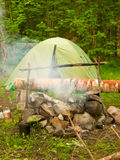 Fire place and tourist tent Royalty Free Stock Photo