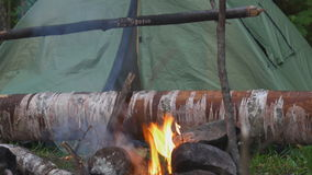 Fire place and tourist tent stock video