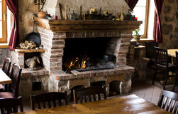 Fire-place. Warm restaurant room with fire-place in middle royalty free stock image