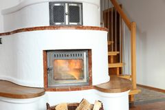 A fire place with fire wood. In living room stock photos