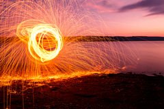 Fire Poi at sunset on the lake Stock Photos