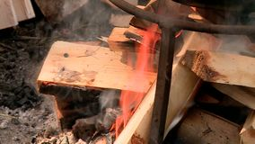 The fire pot wood flame. Wood fire pot tourism on the fire flame stock footage