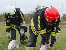 Fire practice. SZEGED, HUNGARY - October 8, 2015: Regional fire-fighting exercise in the training area with urban and contract firefighters. Placing the Stock Images