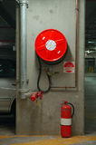 Fire precaution. Fire hose reel and extinguisher in an underground garage Royalty Free Stock Image