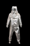 Fire proximity suit. Suit of protection against fire isolated on a black background Royalty Free Stock Photos