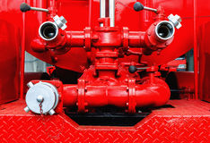 Fire pump machine of fire engine Stock Photos