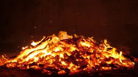 A fire rages nearly burned to the ground. stock footage