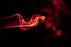 Fire Red abstract smoke design on black background.  Royalty Free Stock Image