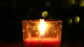 Candle flame. The fire of a red candle burns slowly