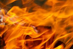 Fire, red and orange texture on a black background. blurry.  Stock Photos