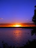 Fire Red Sunrise and a Lake royalty free stock photo