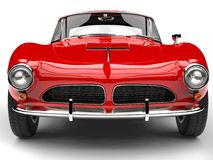 Fire red vintage sports car - front view extreme closeup shot. Isolated on white background Royalty Free Stock Images