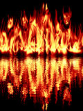 The fire reflected in water on a black background. Royalty Free Stock Photo