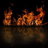 Fire with reflection. In water on black background Stock Image