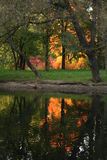 FIRE. Reflection. Golden autumn in Russia. Park. Reflection Royalty Free Stock Image