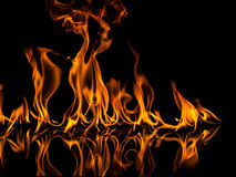 Fire. With reflection on black background Royalty Free Stock Photo