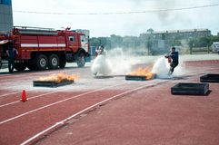 Fire relay race. ORENBURG, ORENBURG region, RUSSIA, 7 August, 2014 year. 23 Championship The Ministry of emergency situations of Russia fire-applied sports. Fire Stock Photography