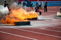 Fire relay race Stock Photography