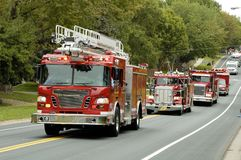 Fire & Rescue 4. Fire and rescue vehicles being driven in a fire muster parade Royalty Free Stock Photography