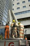 Fire Rescue. Firemen during fire drill in one of Metro Manila's cities Royalty Free Stock Photography