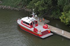 Fire and rescue boat at dock. Overlooking a red fire and rescue boat at a dock Royalty Free Stock Images