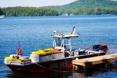 Fire and Rescue Boat at Marina. A fire boat at the dock with a view of the lake in the distance Stock Photo