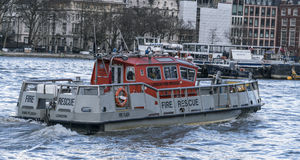 Fire rescue boat on River Thames LONDON, ENGLAND - FEBRUARY 22, Royalty Free Stock Images