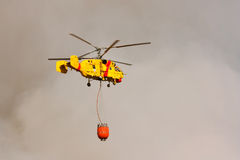 Fire rescue heavy helicopter, with water bucket Royalty Free Stock Photography